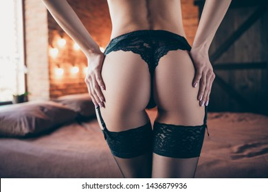 Cropped rear closeup view photo of provocative stunning charming gorgeous trendy big fit large figure waist line ass smooth silky flawless ideal perfect skincare touching hands wear back tight boudoir