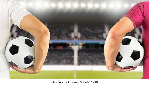 Cropped rear view image of two young players men holding a soccer ball under his arms at stadium with copy space