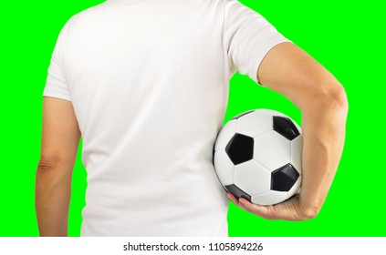 Cropped rearview image of a young man holding a soccer ball under his arms.Isolated cutout on green background with chroma key.Rearview