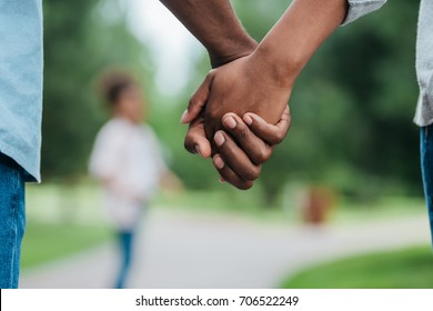 cropped shot of african american couple holding hands