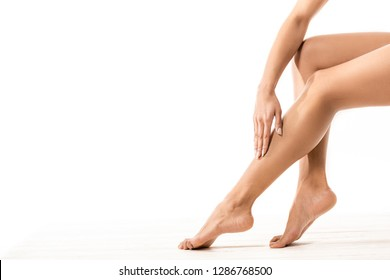 cropped shot of african american woman touching beautiful smooth leg on white