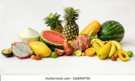 Cropped shot of assortment of exotic fruits, summer fruits, tropical fruits and copy space on white background