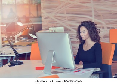 Cropped shot of an attractive young businesswoman working in her office