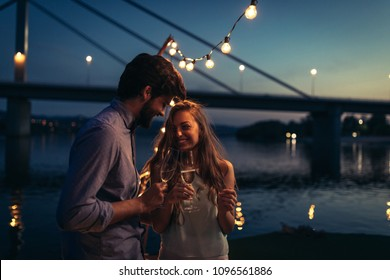Cropped shot of an attractive young couple drinking champagne a on a boat