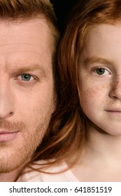 Cropped shot of beautiful redhead father and daughter looking at camera
