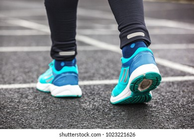 A cropped shot from behind of a woman's running shoes.