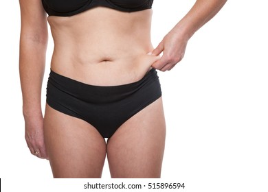 Cropped Shot Body Woman with Excess weight and Subcutaneous Fat. Abdominoplasty Tummy Tuck, Braces, Liposuction, Removal of keloid scars, and Health Care. Isolated on white background.