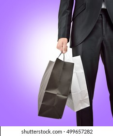 Cropped shot of a business man shopping with blue background