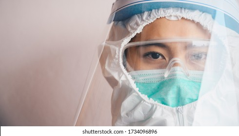 Cropped shot of confidence healthcare worker while wearing PPE suit before working in hospital during Covid-19 pandemic. PPE is equipment that will protect the user against health or safety at work.