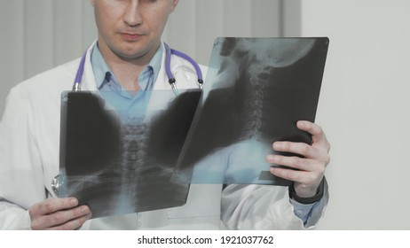 Cropped shot of a doctor examining x-ray scans of a patient