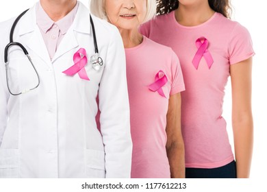 cropped shot of doctor and women with breast cancer awareness ribbons standing isolated on white