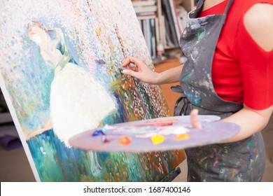 Cropped shot of a female artist painting an artwork with oil paint. Artistry, creativity concept