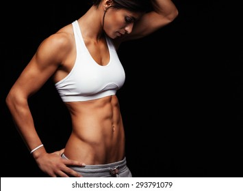 0bf7bec2ad Cropped shot of fit woman s torso with her hands on hips. Female with  perfect abdomen