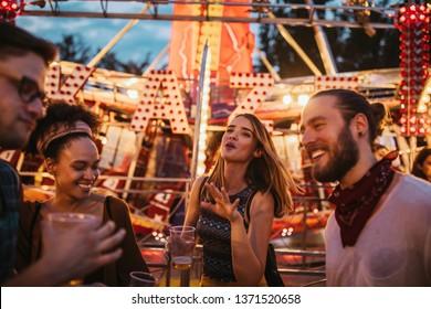 Cropped shot of four friends at a amusement park