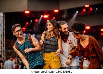 Cropped shot of four friends having fun at a music festival