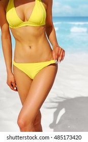 Cropped shot of a gorgeous woman in a bikini at the beach