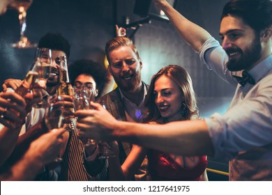 Cropped shot of a group of friends celebrating with drinks