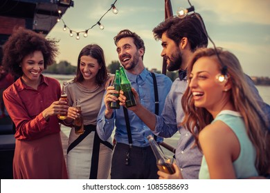 Cropped shot of a group of friends having fun on a boat