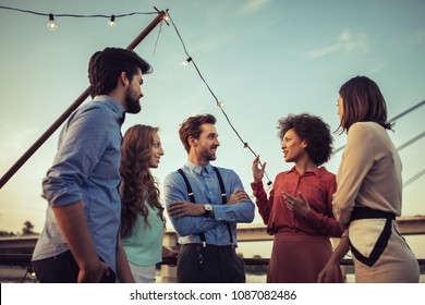 Cropped shot of a group of friends having a conversation on a boat