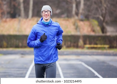 Cropped shot of a happy young man running outdoors.
