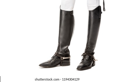 cropped shot of horsewoman standing in leather boots isolated on white