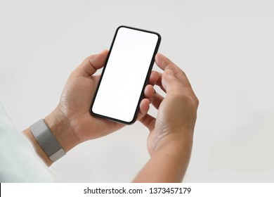 Cropped shot male hand holding blank screen mobile smartphone