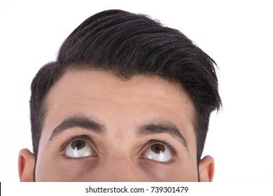 Cropped shot of man's head, he looks to up direction. Isolated on white background.