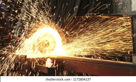 Cropped shot of a metalworker welding steel pipes with sparks flying