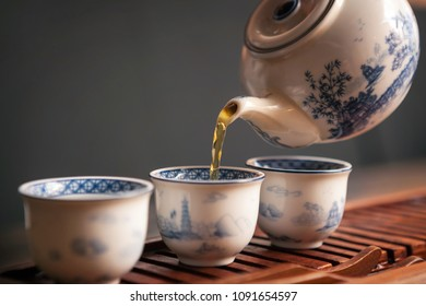 Cropped shot of pouring tea in traditional chinese teaware.