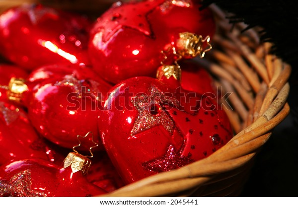 cropped shot of red christmas ornaments in thttp://admin.shutterstock.com/78625/uploads/thumb_large/4363/4363,1161565020,3.jpg http://admin.shutterstock.com/78625/uploads/thumb_large/4363/4363,1161565020,3.jpghe shape of a heart