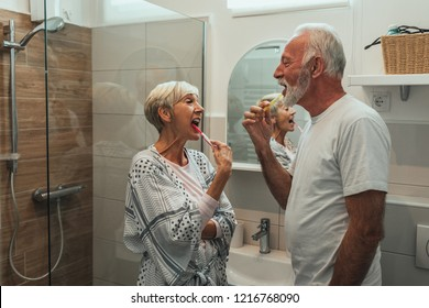 Cropped shot of a senior couple brushing their teeth together in the bathroom