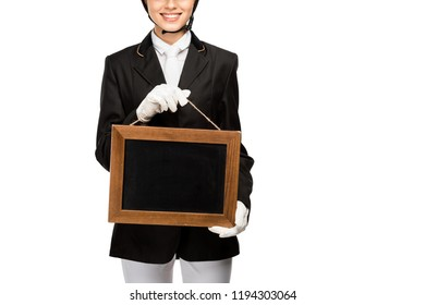 cropped shot of smiling young horsewoman in uniform holding blank chalkboard isolated on white
