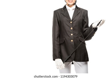 cropped shot of smiling young horsewoman in uniform holding horseman stick isolated on white