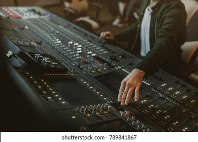 cropped shot of sound producer working with recording equipment