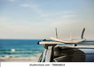Cropped shot of surfboards over the roof of the car
