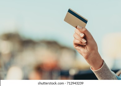 cropped shot of woman holding credit card