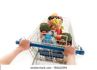 cropped shot of woman pushing shopping trolley with grocery bags and plastic bottle of water isolated on white