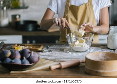 cropped shot of woman putting margarine into bowl during pie preparation
