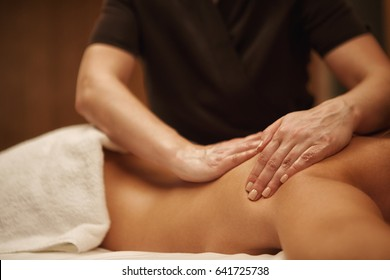 Cropped shot of woman receiving full body massage at spa center copyspace sexy body therapy recreation lifestyle health vitality pampering skin treatment masseur masseuse working professional service