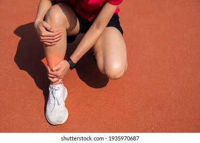 Cropped shot of woman runner suffering pain from Shin splint. It often happens in the front or inside of the lower leg from overtraining. Conceptual of common running injuries.