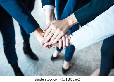 Cropped shot of women putting hands together in circle. Closeup shot of female hands. Teamwork concept