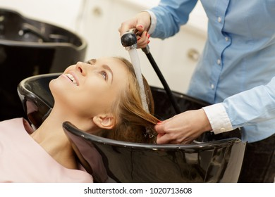 Cropped shot of a young beautiful woman smiling hceerfully getting her hair washed by a professional hairdresser at the beauty salon enjoyment pleasure beauty recreation service styling lifestyle.