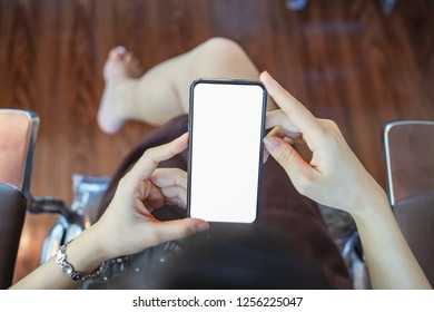 Cropped shot of a young businesswoman using on a smartphone in a modern office