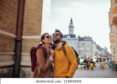 Cropped shot of a young couple exploring a foreign city