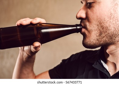 Cropped shot of young man drinking beer