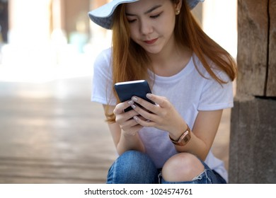 Cropped shot of a young woman using her cellphone.