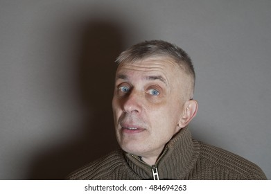 Cropped studio portrait of a man with a curious or surprised look