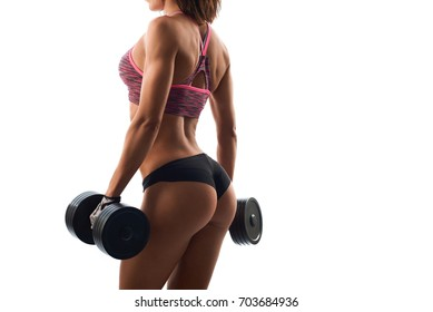 Cropped studio rearview shot of a sexy fitness woman with perfect toned buttocks posing with heavy dumbbells isolated on white copyspace beauty healthcare sports activity gym concept.