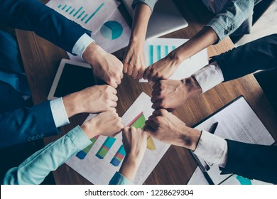Cropped top above high angle view photo of hands holding fists in round circle stylish elegant classy business sharks over table desk paper documents gathering work station place