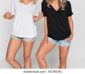 Cropped two girls in white and black t-shirt